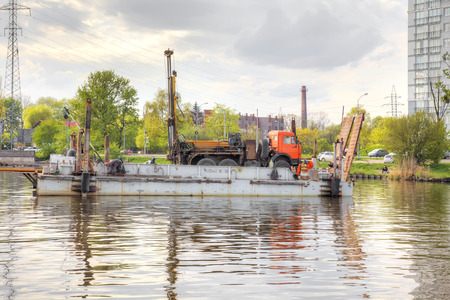 KALININGRAD, RUSSIA - April 28.2018: Drill rig on a barge in the middle of the Pregolya River