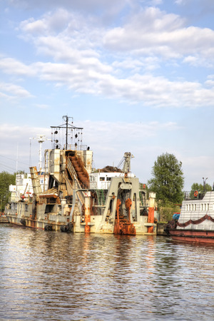 KALININGRAD, RUSSIA - April 28.2018: A multi-pack self-propelled dredger moored to the bank of the Pregolya river in a cargo port