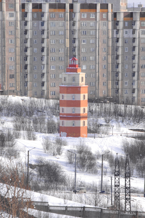 MURMANSK, RUSSIA - March 25.2009: Lighthouse. Memorial to the sailors who died in peacetime. Cityscape