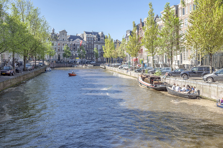 AMSTERDAM, NETHERLANDS - May 01.2011: City canals and embankments in the capital of the kingdom
