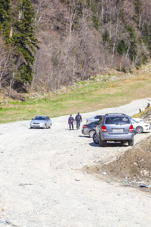DOMBAY, RUSSIA - May 03.2015: Armed police patrol on a mountain road near the village of Dombay