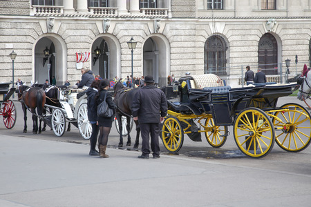 VIENNA, AUSTRIA - May 05.2011: A carriage on Heldenplatz square near the royal residence of the Hofburg. Walk through the historic center of the city on a real carriage