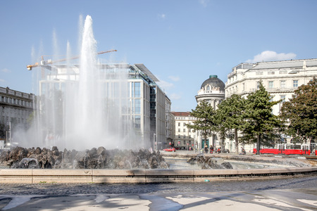 VIENNA, AUSTRIA - May 05.2011: Schwarzenbergplatz Square. Fountain High jet near the monument to the soldiers of Sovetsk who died during the liberation of Austria from fascism