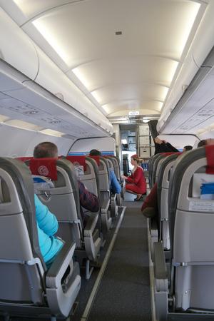 ELLINAIR, GREECE � March 18.2016: Stewardess checks up an order in a salon aboard the airplane prepared to flight