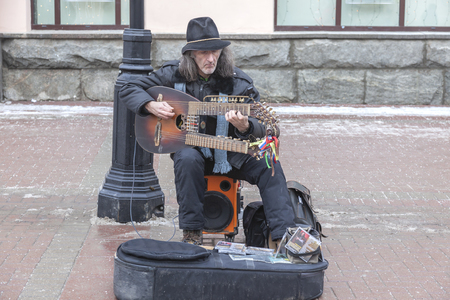 MOSCOW, RUSSIA - January 02.2013: A talented musician makes a living playing the instrument of the sadora