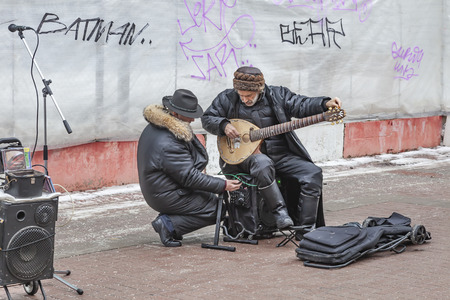 MOSCOW, RUSSIA - January 02.2013: Street musicians tune musical instruments on Arbat Street