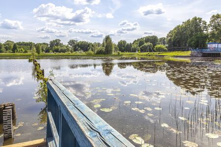 Neighborhood of the city Vyshny Volochyok. Tsna River. Measuring the surface level of the river after the dam