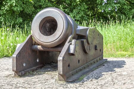 Antique cannon mortar on the shores of the Gulf of Finland in the city of Vyborg