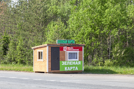 VIBORG, RUSSIA - June 05.2019: Registration of an international motor third party liability insurance policy Green Card at a mobile point on the highway near the border