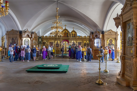 ISLAND VALAAM, REPUBLIC OF KARELIA, RUSSIA - June 06.2019: Believers in the Lower Church of the Transfiguration of the Savior Cathedral Valaam Monastery