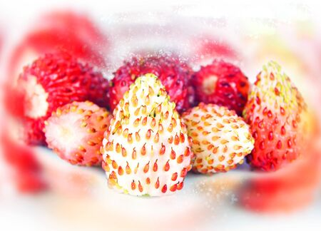 Ripe small berries of Strawberries. Background bokeh and color blur