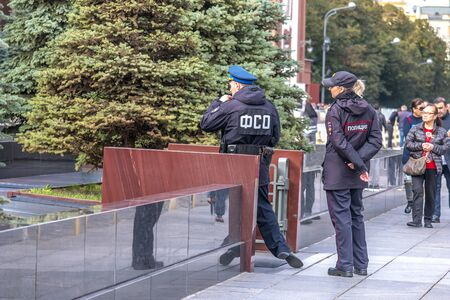MOSCOW, RUSSIA - October 03.2019: Police and FSO monitor order near the entrance to the Lenin Mausoleum on Red Square Reklamní fotografie