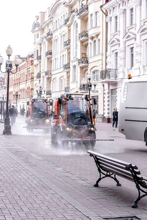 MOSCOW, RUSSIA - October 16.2019: Machines watered and pick up garbage on the pedestrian street Old Arbat