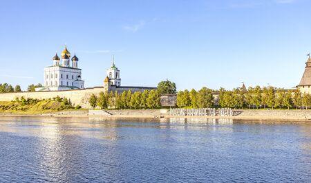 PSKOV, RUSSIA - June 03.2019: Pskov Krom (Kremlin) on the Velikaya River. City landscape. Evening. The inscription in large white letters on the shore - Here begins Russia
