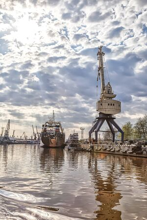 KALININGRAD, RUSSIA - April 28.2018: Portal cranes in a cargo port on the banks of the Pregolya River
