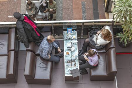 MOSCOW, RUSSIA - January 04.2012: A family with a child drinks tea in a city cafe