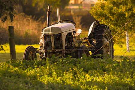 flaking: Old Tractor at Sunrise