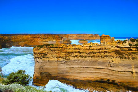 unusually: The Razor Back is an unusually thing and tall rock formation sticking high above the OceanSee this Stunning site on the Great Ocean Road in Victoria, Australia