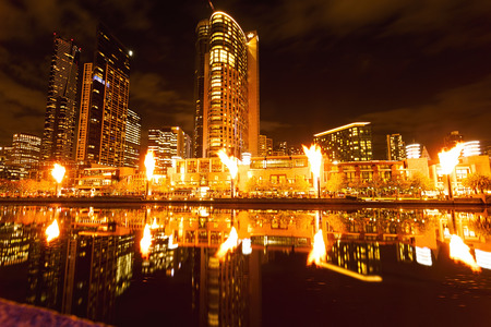 sky scrapers: Stunning Image of the Flames at the Crown Casino at Melbourne in Victoria Australia.The Gas Flames are at their Fullest Hight Lighting up the whole Image and Reflected in the Yarra River.