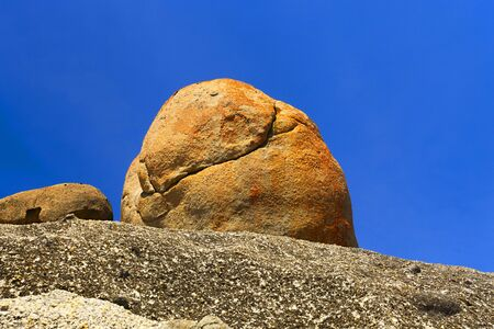is cloudless: Large Rocks in front to a Cloudless Blue Sky.