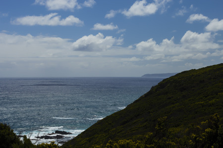 top veiw: Veiw from the Top of the Cape Otway Lighthouse.The Green Hills Roll down to the Sea which hides dangerous Rocks.