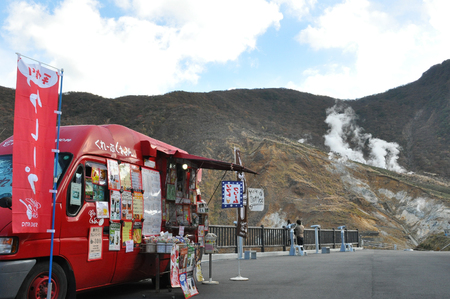 Hakone, Japan: November 4, 2014-Landscape picture of attractive place named Hakone-Yumoto Onsen with the grocery van in foreground Archivio Fotografico - 123677851
