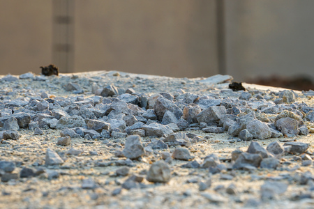 Texture and background of crashed stone pile at the construction site with light of sunset Archivio Fotografico - 123720524