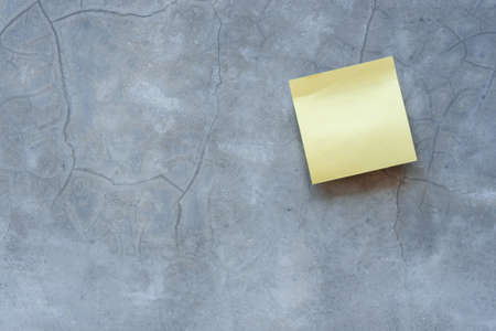 Top view reminder yellow sheet isolated on concrete background