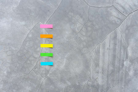 Top view colorful reminder sheets isolated on concrete  background Reklamní fotografie