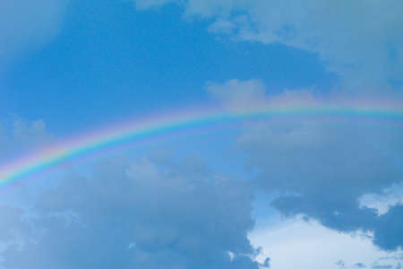 Abstract background of rainbow after raining with blue sky background Reklamní fotografie