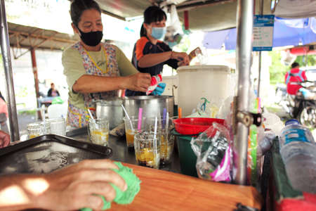 Songkhla, Thailand:July 29, 2020 - Local sweet of Hat Yai called Mun Diuey. Mixed sweeten fruit in the syrup. Famous street food at Songkhla Redakční