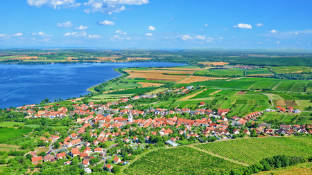 Beautiful Czech landscape around Moravian village Pavlov captured on 16:9 aerial photography. The picturesque village is surrounded by amazing vineyards and Nove Mlyny Reservoirs. 写真素材