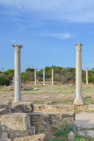 Vertical picture of Corinthian columns surrounded by ancient ruins with blue sky above. Taken in famous Salamis, near Famagusta, Turkish Northern Cyprus. Salamis was famous ancient Greek city-state.