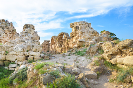 Walls ruins of ancient Greek city-state Salamis in Northern Cyprus taken on a sunny day with light clouds above. The archeological site is located near Famagusta, in Turkish part of Cyprus.