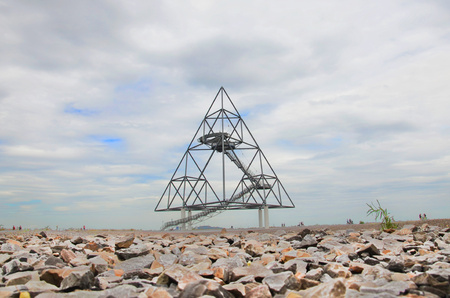 Ground level photography of the Tetrahedron in Bottrop, Germany taken on a cloudy summer day. The walkable steel structure in the form of a tetrahedron built on a mine dump is popular with tourists.
