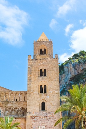 Detail of beautiful Cefalu Cathedral in Cefalu, Sicily, Italy with blue sky. Roman Catholic basilica in Norman architectural style