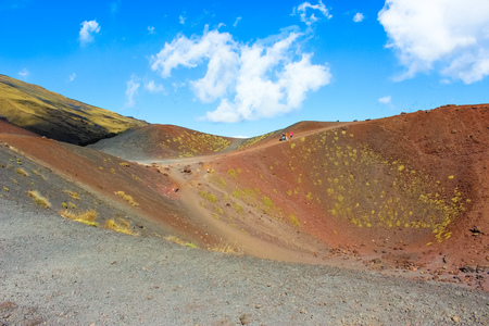 Amazing Silvestri craters on Mount Etna in Italian Sicily. The impressive volcanic landscape is a popular tourist destination. Captured with hikers on the edge of the crater. Banco de Imagens