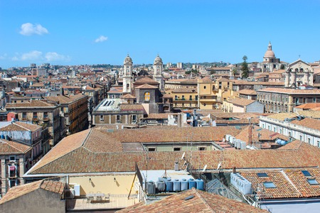 Beautiful cityscape of Sicilian city Catania, Italy taken from a view point above the city center. Catania has many historical sites and is a popular tourist attraction. Blue sky, sunny day.