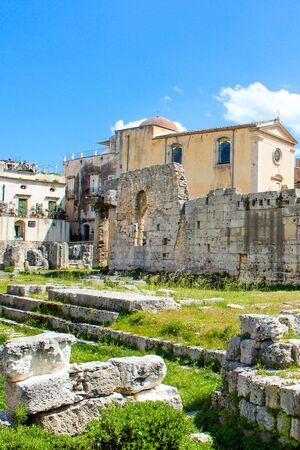 Historical ruins of Temple of Apollo in Ortigia Island, Syracuse, Sicily, Italy. Ancient Greek monument, significant archaeological site. Popular tourist place. Temple ruins.