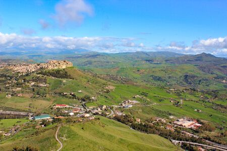 Amazing view of village Calascibetta in Sicily taken with adjacent green hilly landscape. Photographed from the view point in Enna. Beautiful landscapes in Italy. Historical Arab village.