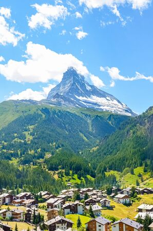 Picturesque Swiss village Zermatt with famous Matterhorn in background. Amazing nature, Switzerland. The summer Alps. Alpine landscape. Travel destination and tourist attraction. Europe.