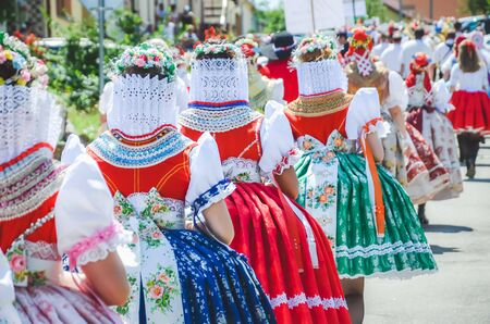 Young women during parade in traditional Czech folklore costumes. Photographed in Southern Moravia, Czechia. Moravian motifs. Festive, tradition. Stock fotó