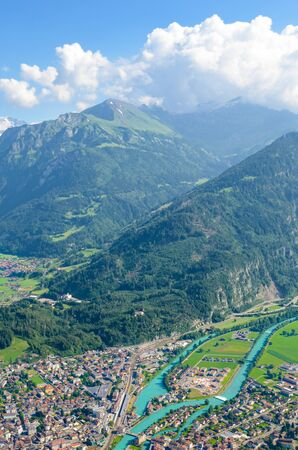 Beautiful landscape near Interlaken taken with Aare river and Swiss Alps in background. Photographed from Harder Kulm, Switzerland in summer season. Amazing Alpine landscapes.