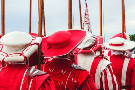 Traditional parade on Swiss National Day. National holiday of Switzerland, set on 1st August. Celebration of the founding of the Swiss Confederacy. Independence day. Historical red white costumes.