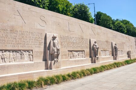Geneva, Switzerland - July 19, 2019: The Reformation Wall, a monument to the Protestant Reformation of the Church. Depicting numerous Protestant figures. Oliver Cromwell, Roger Williams. Sajtókép