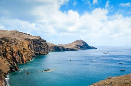 Amazing cliffs in Ponta de Sao Lourenco, the easternmost point of Madeira Island, Portugal. Cliffs by the Atlantic ocean. Portuguese volcanic landscape. Travel destination and tourist attraction.
