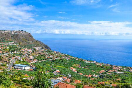 Amazing view of Arco da Calheta, Madeira Island, Portugal. Picturesque village located on a hill above the Atlantic ocean. Green banana plantations. Portuguese landscape. Tourist destination.