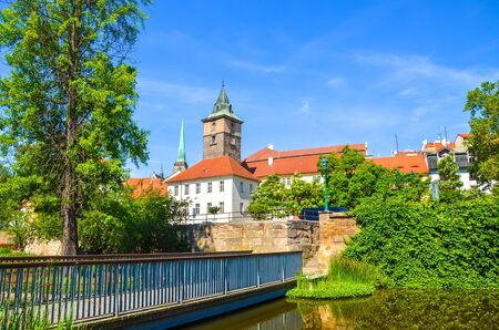 Beautiful cityscape of Pilsen, Czech Republic with dominant Water Tower, Vodarenska vez in Czech, photographed from park by Mlynska Strouha. Plzen city, Bohemia, Czechia. Tourist destination.