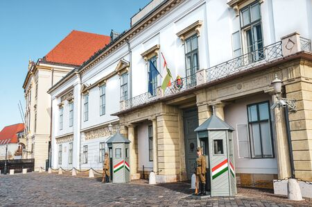 Budapest, Hungary - Nov 6, 2019: Guards in front of the Hungarian Presidential Palace, Sandor Palace. Armed presidential guards in uniforms standing in front of the building. Honor guard. Editorial