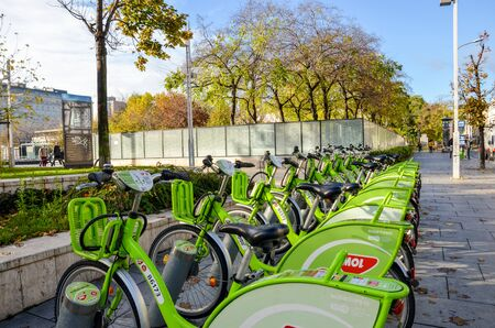 Budapest, Hungary - Nov 6, 2019: Public green bikes for rental in the center of the Hungarian capital city. Bike-sharing. Eco-friendly means of transport. Ecological measures in the cities. Bicycles.